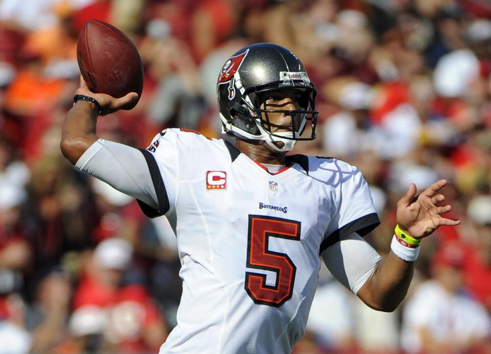 Tampa Bay Buccaneers quarterback Josh Freeman (5) throws a pass against the Washington Redskins during the first quarter of an NFL football game Sunday, Sept. 30, 2012, in Tampa, Fla. (AP Photo/Brian Blanco)