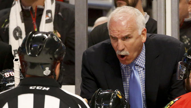 Chicago Blackhawks coach Joel Quenneville, right, talks with the referee in the first period against the Boston Bruins during Game 2 of the NHL hockey Stanley Cup Finals, Saturday, June 15, 2013, in Chicago. (AP Photo/Nam Y. Huh)