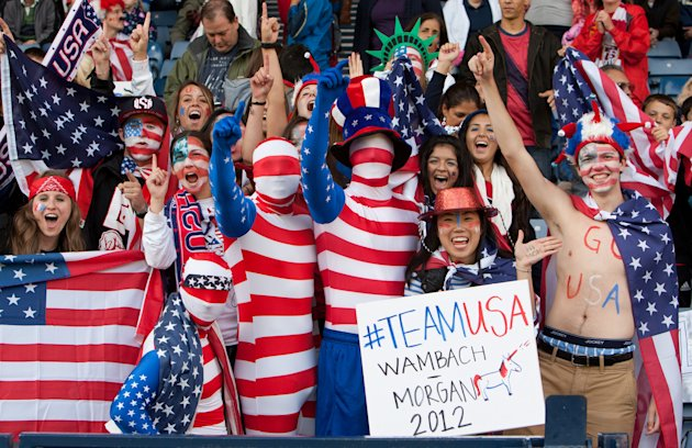 U.S. supporters cheer during the group G women&#39;s soccer match between the United States and Colombia at the London 2012 Summer Olympics, Saturday, July 28, 2012, at Hampden Park Stadium in Glasgow, Scotland. (AP Photo/Chris Clark)
