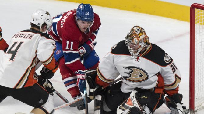 Anaheim Ducks goalie Frederik Andersen makes a save off Montreal Canadiens' Brendan Gallagher as Ducks defenseman Cam Fowler moves in during the second period of an NHL hockey game, Thursday, Dec. 18, 2014, in Montreal. (AP Photo/The Canadian Press, Paul Chiasson)