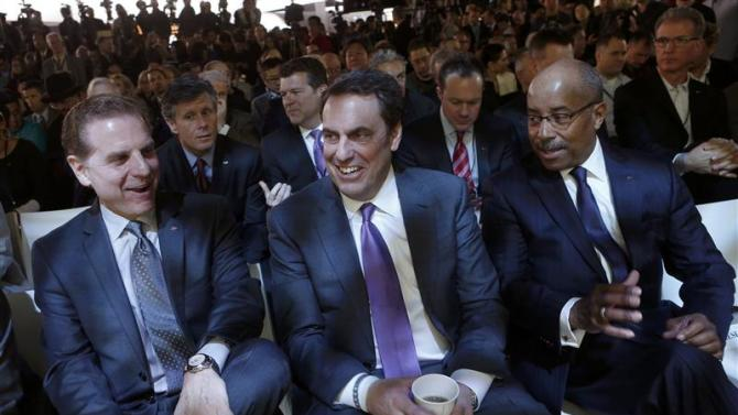 GM officials attend the Cadillac presentation during the press preview day of the North American International Auto Show in Detroit