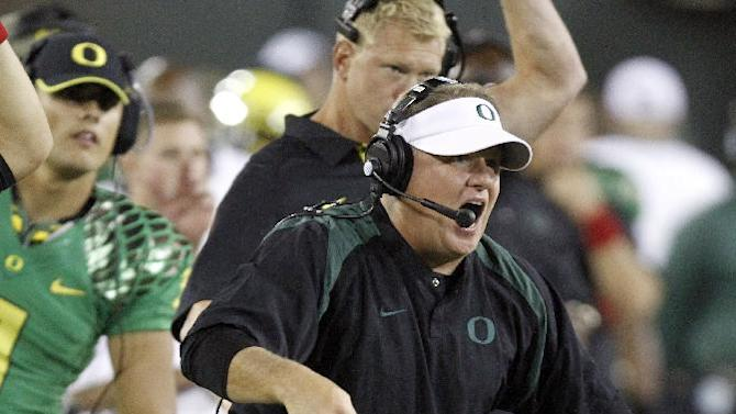FILE - In this Sept. 1, 2012 file photo, Oregon football coach Chip Kelly reacts on the sideline during the second half of their NCAA college football game against Arkansas State in Eugene, Ore. The Philadelphia Eagles have hired Kelly after he originally chose to stay at Oregon. Kelly becomes the 21st coach in team history and replaces Andy Reid, who was fired on Dec. 31 after a 4-12 season.  (AP Photo/Don Ryan, FIle)