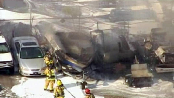 In this image taken from video, first responders work to extinguish burning vehicles after a small plane crashed into a parking lot near Fort Lauderdale Executive Airport in Fort Lauderdale, Fla. Friday afternoon, March 15, 2013, killing all three people onboard and burning about a dozen cars. No one on the ground was hurt. (AP Photo/APTN)