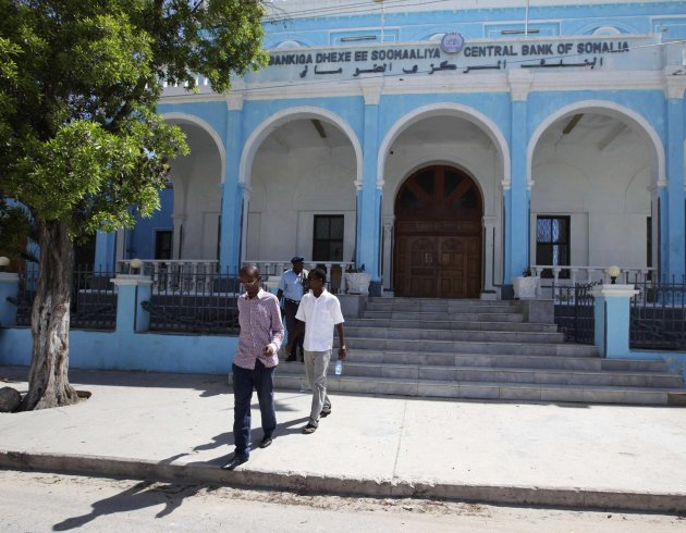 File photo of people walking outside Somalia's central Bank in Hamarwayne district, south of Mogadishu