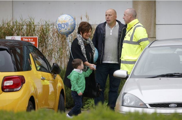 Colette McLoughlin, the mother of Coleen Rooney arrives with Coleen's son Kai at Liverpool Womens Hospital in Liverpool, Northern England