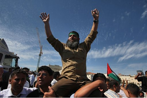 A Palestinian prisoner wearing a Hamas headband is welcomed in the West Bank city of Ramallah