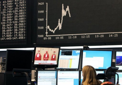 <p>A trader watches a screen displaying the judges of the Second Senate of the Federal Constitutional Court at the stock exchange in Frankfurt/M. European stock markets rose and the euro rallied after the eurozone cleared a key hurdle towards resolving its debt crisis as Germany's top court approved a new firewall.</p>