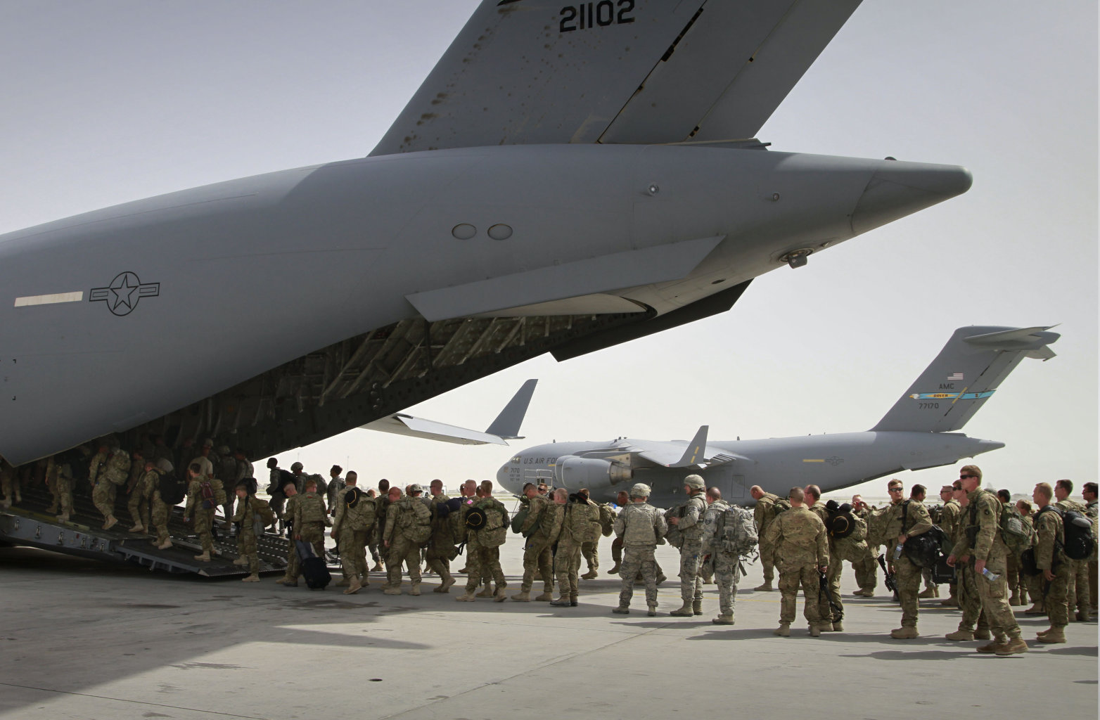 U.S. soldiers board a U.S. military plane, as they leave Afghanistan, at the U.S. base in Bagram north of Kabul, Afghanistan. The United States is not alone in pulling combat troops off the Afghan battlefield. More than a dozen other countries have draw down plans that combined with the U.S. withdrawal will shrink the foreign military footprint in Afghanistan by more than 40,000 troops by the close of next year.