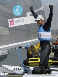 Ben Ainslie of Great Britain celebrates his gold medal during the Finn dinghy class medal race at the London 2012 Summer Olympics, Sunday, Aug. 5, 2012, in Weymouth and Portland, England. (AP Photo/Francois Mori)