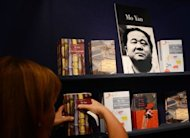 A poster of Chinese author Mo Yan is on display at the 64th Frankfurt Book Fair. Mo -- one of China's leading writers of the past half-century -- has won the Nobel Literature Prize for his writing that mixes folk tales, history and the contemporary, the Swedish Academy announced