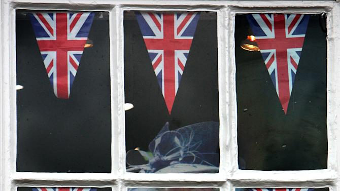 A shop window with a display in honour of Britain's Queen Elizabeth II Diamond Jubilee in Yarm, England, Thursday, May 31, 2012. AP Photo/Scott Heppell)