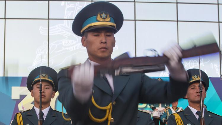 Kazakh guards perform during the Constitution Day celebrations in Almaty