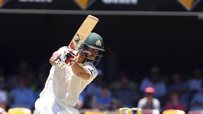 Australia's Mitchell Johnson plays a shot on his way to a half century on the third day of the second cricket test against India in Brisbane, Australia, Friday, Dec. 19, 2014.(AP Photo/Tertius Pickard)