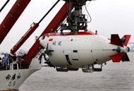 "The Chinese submersible ""Jiaolong"" is lifted into the Huanghai sea in July 2011. A Chinese submersible that last month set a new national record will dive in the South China Sea next year, state media said Tuesday, as Beijing asserts its claim over the resource-rich area"