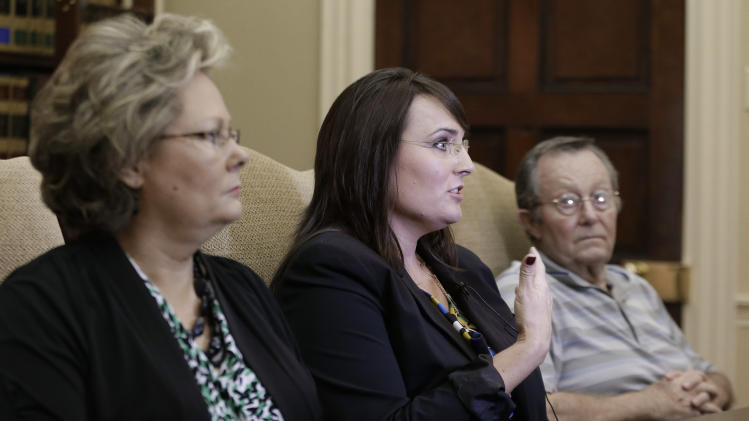 Tracy Barreiro, center, talks about her mother, Janet Russell, on Friday, Oct. 5, 2012, in Nashville, Tenn. Janet Russell is suffering from a deadly fungal meningitis that 39 people in six states have also contracted after getting steroid shots for back pain. At left is Barreiro's sister, Teresa Russell, and at right is their father, Bobby Russell. (AP Photo/Mark Humphrey)