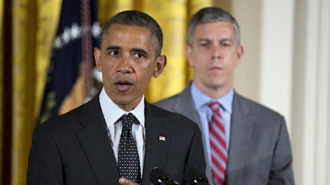 FILE - In this June 3, 2013 file photo, Education Secretary Arne Duncan, right, listens as President Barack Obama speaks in the East Room of the White House in Washington. The effort to rewrite the flawed No Child Left Behind education law is heading for a partisan confrontation as House Republicans champion legislation that would strip the federal government of its powers to set standards for students and schools. (AP Photo/Evan Vucci, File)