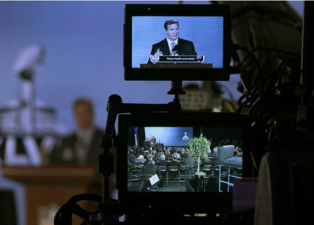 NFL Commissioner Roger Goodell is seen on a television monitor as he answers questions during an NFL Super Bowl XLVII football game news conference at the New Orleans Convention Center, Friday, Feb. 1