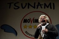 <p>Comedian-turned-politician Beppe Grillo speaks during his final rally in Rome's Piazza San Giovanni, on February 22, 2013. Grillo and his Five Star Movement are the wild card in Italian politics, after making big gains among voters with a blend of populism and anti-corruption initiatives.</p>