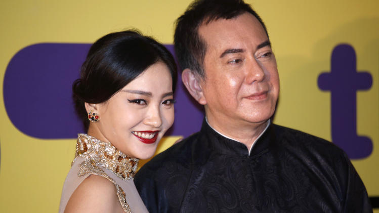 Chinese actress Zhou Chu Chu, left, and Hong Kong actor Anthony Wong pose for the photographers at the red carpet of 37th Hong Kong International Film Festival (HKIFF) Grand Opening in Hong Kong Sunday, March 17, 2013. (AP Photo/Vincent Yu)