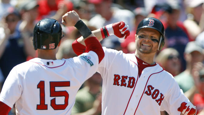 Boston Red Sox's Cody Ross, right, celebrates his three-run home run that also drove in Boston Red Sox's Dustin Pedroia (15) in the fourth inning of an interleague baseball game against the Atlanta Braves in Boston, Sunday, June 24, 2012. (AP Photo/Michael Dwyer)