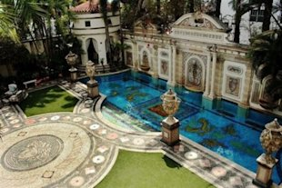 Casa Casuarina&amp;#39;s pool is lined in gold. Click the photo to go to the listing (with many more pictures).