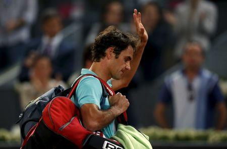 Federer of Switzerland leaves the court after his defeat by Kyrgios of Australia at the end of their match at the Madrid Open tennis tournament in Madrid