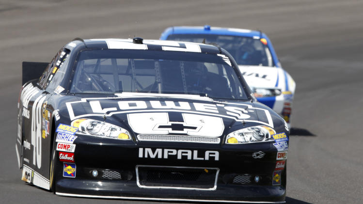 Jimmie Johnson drives through the first turn early in the running of the NASCAR Sprint Cup Series Brickyard 400 auto race at Indianapolis Motor Speedway in Indianapolis, Sunday, July 29, 2012. (AP Photo/Tom Strattman)