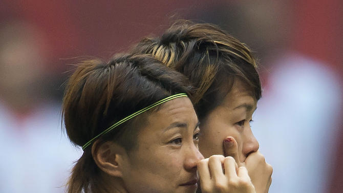 Japan's Yukari Kinga, left, and teammate Azusa Iwashimizu react after losing to the United States in 5-2 in the FIFA Women's World Cup soccer championship in Vancouver, British Columbia, Canada, Sunday, July 5, 2015. (Jonathan Hayward/The Canadian Press via AP) MANDATORY CREDIT