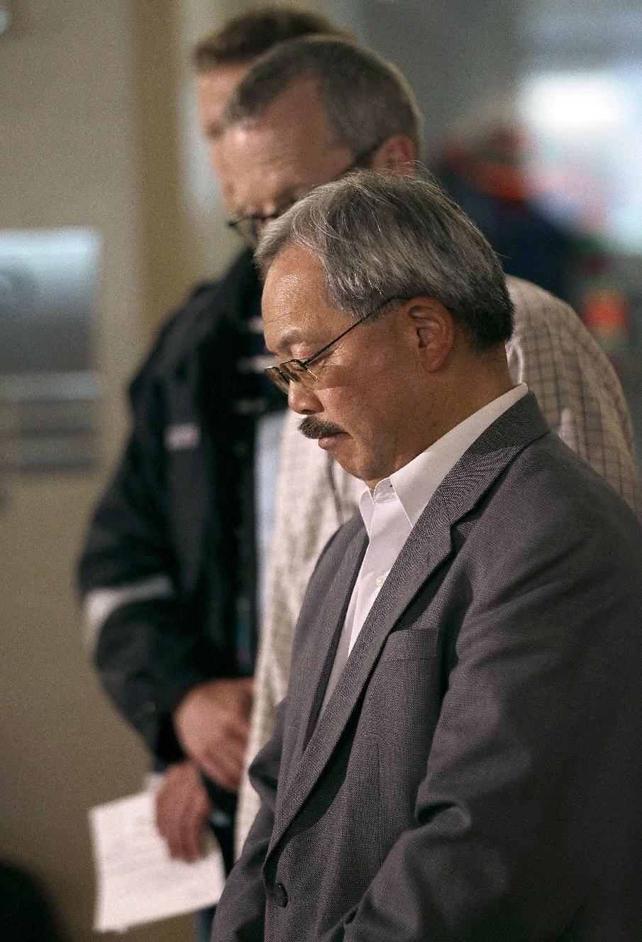 San Francisco Mayor Ed Lee listens to speakers at a news conference after Asiana Flight 214 crashed at San Francisco International Airport in San Francisco, Saturday, July 6, 2013. (AP Photo/Jeff Chiu)