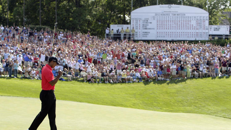 Tiger Woods pumps his fist after making a birdie putt on the 18th hole during the final round of the Memorial golf tournament, Sunday, June 3, 2012, in Dublin, Ohio. Woods birdied three of his last four holes to win the Memorial and match tournament host Jack Nicklaus with his 73rd title on the PGA Tour. (AP Photo/Jay LaPrete)