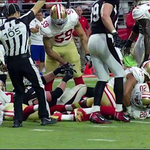 San Francisco 49ers cornerback Perrish Cox recovers Arizona Cardinals wide receiver Larry Fitzgerald's fumble