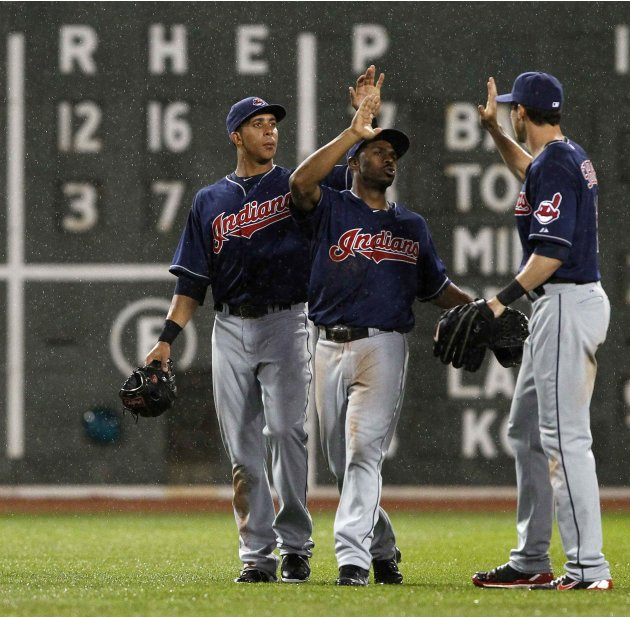 Indians outfielders Brantley, Bourn, and Stubbs celebrate their win over the Red Sox in game at Fenway Park in Boston