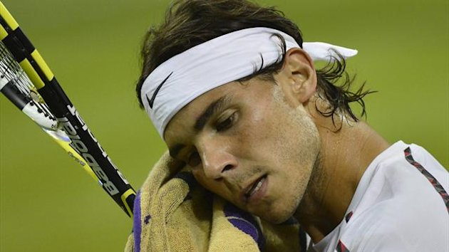 TENNIS Rafael Nadal of Spain wipes his face in his men's singles tennis match against Lukas Rosol of the Czech Republic at the Wimbledon tennis championships in London June 28, 2012.