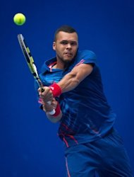 Jo-Wilfried Tsonga of France hits a return against Denis Istomin of Uzbekistan during their China Open match on Tuesday. Tsonga battled to a three-set victory over unseeded Istomin