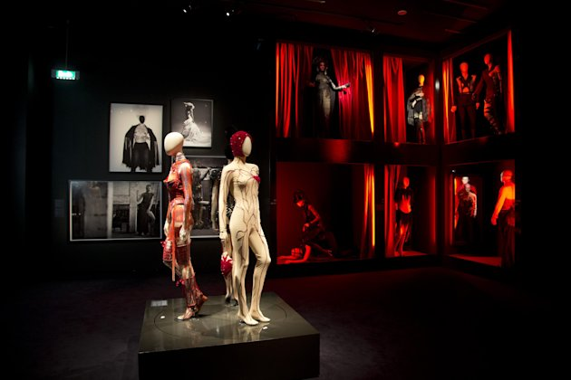 Mannequins inspired by the red light district are seen in the exhibit of French fashion designer Jean Paul Gaultier called &quot;The Fashion World of Jean Paul Gaultier, from the sidewalk to the catwalk&quot;, at Kunsthal museum in Rotterdam, Netherlands, Friday Feb. 8, 2013. The exhibit opens to the public on Feb. 10, 2013. (AP Photo/Peter Dejong)