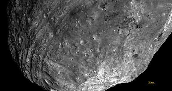Dark Asteroids Streak Vesta's Surface With Carbon, NASA Probe Finds
