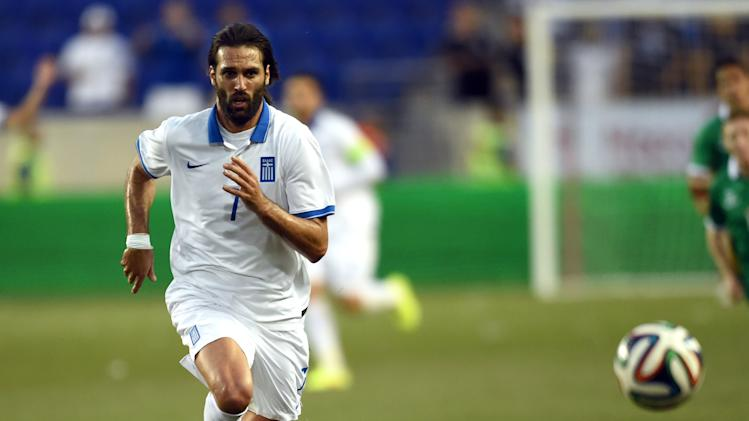Greece's Giorgos Samaras pursues the ball during an international friendly match against Bolivia at Red Bull Arena in Harrison, New Jersey on June 6, 2014