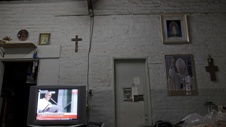 A TV set shows a repeat of Pope Francis delivering his Angelus prayer at the Vatican, inside a home in the Villa 21-24 slum in Buenos Aires, Argentina, Sunday, March 17, 2013.  Argentine's former Cardinal Jorge Mario Bergoglio was chosen as leader of the Catholic Church on March 13, 2013. (AP Photo/Natacha Pisarenko)