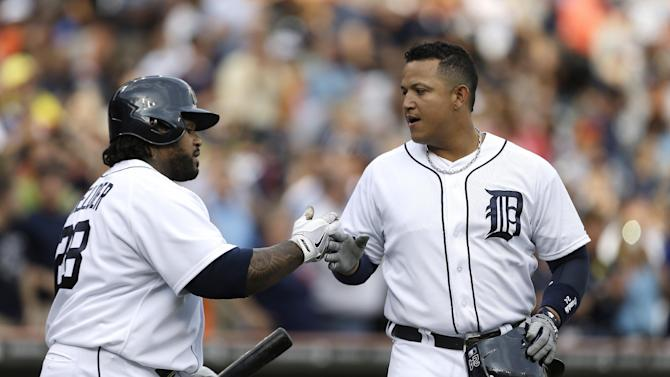 Detroit Tigers' Miguel Cabrera, right, is congratulated by Prince Fielder, left, after hitting a two-run home run against the Baltimore Orioles in the first inning of a baseball game in Detroit, Monday, June 17, 2013.  (AP Photo/Paul Sancya)