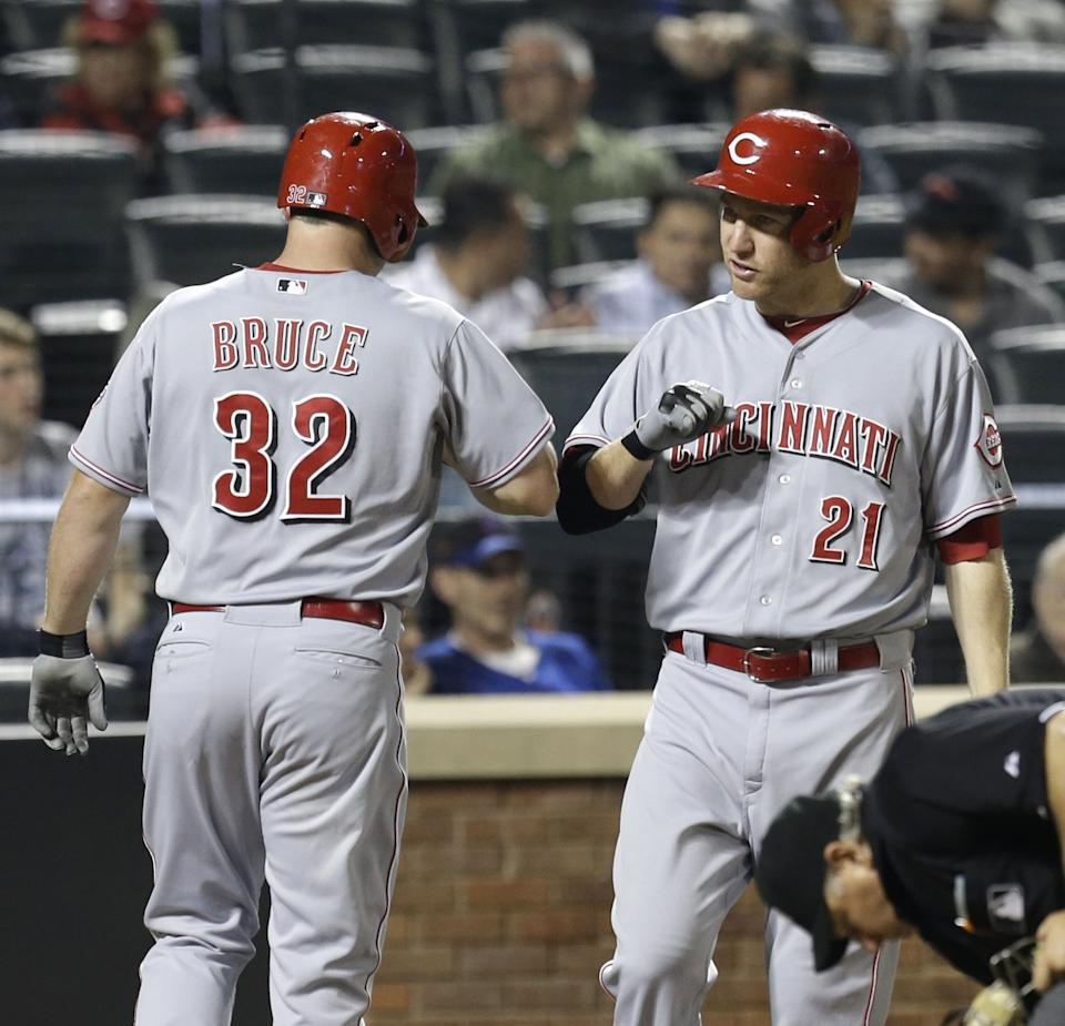 Cincinnati Reds' Jay Bruce, left, is greeted by Todd Frazier after he hit a solo home run during the sixth inning of the baseball game against the New York Mets at Citi Field Monday, May 20, 2013 in New York. (AP Photo/Seth Wenig)