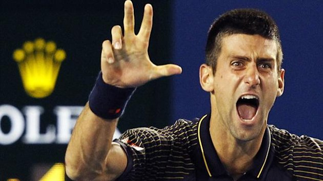 Novak Djokovic celebrates his third consecutive Australian Open title