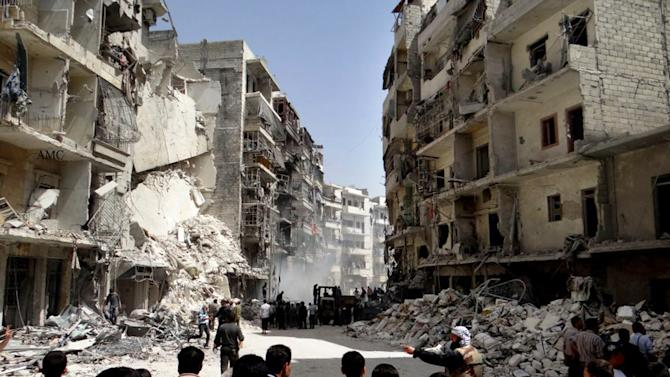 This citizen journalism image taken on Sunday, April 7, 2013 provided by Aleppo Media Center AMC which has been authenticated based on its contents and other AP reporting, shows Syrian citizens searching for bodies on the rubble of damaged buildings that were attacked by Syrian forces airstrikes, at al-Ansari neighborhood, in Aleppo, Syria. More than 70,000 people have died since Syria's crisis erupted in March 2011. The Syria-based Violations Documentation Center says nearly 9,000 government troops have been killed in two years of fighting between President Bashar Assad's forces and rebels trying to topple him. (AP Photo/Aleppo Media Center AMC)