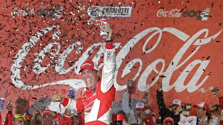 Kevin Harvick celebrates in victory lane after winning the NASCAR Sprint Cup series Coca-Cola 600 auto race at Charlotte Motor Speedway in Concord, N.C., Sunday, May 26, 2013. (AP Photo/Chuck Burton)