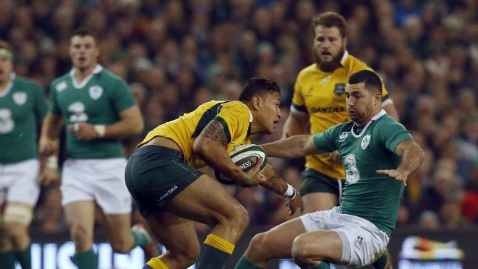 Ireland's Kearney tackles Australia's Falou during their international rugby test match in Dublin