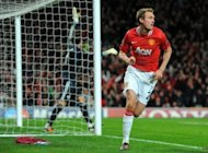 Manchester United's Scottish midfielder Darren Fletcher celebrates scoring against Benfica at Old Trafford in Manchester, north-west England on November 22, 2011. Manchester United manager Sir Alex Ferguson has confirmed Fletcher has still to start training following diagnosis of a chronic bowel complaint