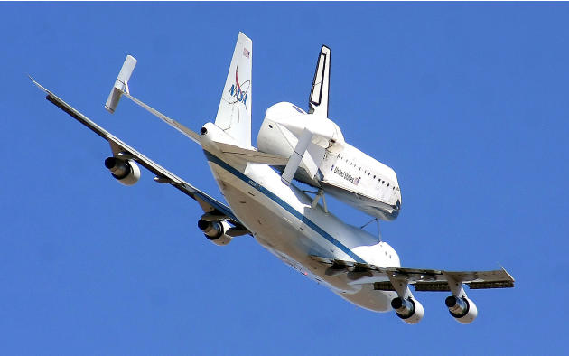 The retired shuttle Endeavour piggy-backs a modified Boeing 747 Shuttle Aircraft Carrier during its final flight Thursday, Sept. 20, 2012 as the pair soar over White Sands Missile Range east of Las Cr