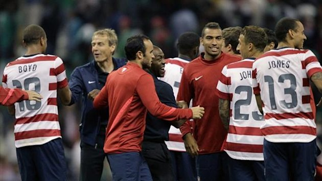 US coach Jurgen Klinsmann celebrates with his players after their team's victory against Mexico during their international friendly at Azteca stadium in 2012 (Reuters)