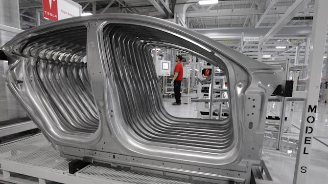 Tesla Model S frames are shown in the assembly area at the Tesla factory in Fremont, Calif., Friday, June 22, 2012. The first Model S sedan car will be rolling off the assembly line on Friday.  (AP Photo/Paul Sakuma)