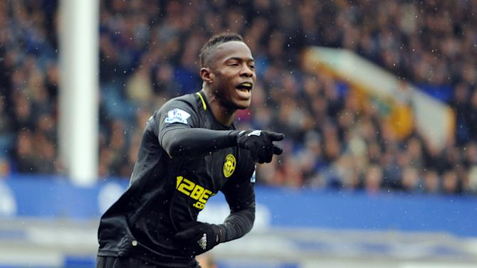 FILE - In this March 9, 2013 file photo, Wigan Athletic's Maynor Figueroa celebrates after he scores the first goal of the game for his side during their English FA Cup sixth round soccer match against Everton at Goodison Park in Liverpool, England. Figueroa has joined Premier League newcomer Hull on a free transfer following his release by Wigan. (AP Photo/Clint Hughes, File)
