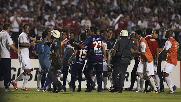 Players of Brazil's Sao Paulo (in white) argue with players of Argentina's Tigre at the end of the first half of their Copa Sudamericana final second leg in Sao Paulo (Reuters)